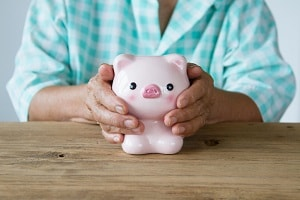 Senior with Piggy Bank