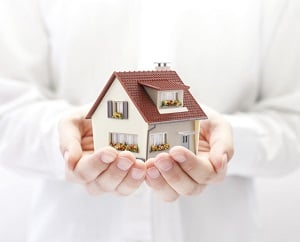 Small house being held in hands