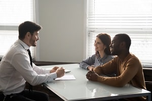 You couple meeting with an attorney. Possibly to discuss an estate plan.