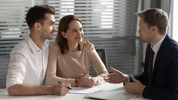 Young unmarried couple meeting with estate planning lawyer