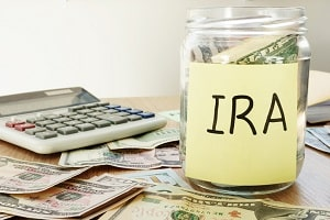 Jar labeled IRA filled with money