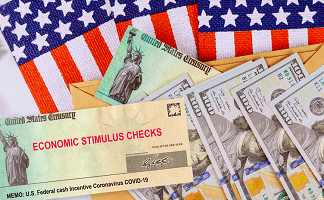 economic stimulus check and cash in front of American flags