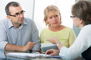 Couple meeting with Elder Law Lawyer