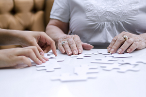 Elderly woman working on a memory exercise puzzle