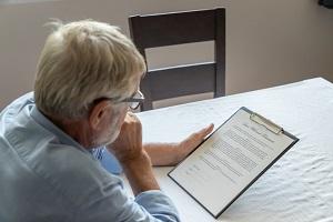 Senior man examining estate planning document